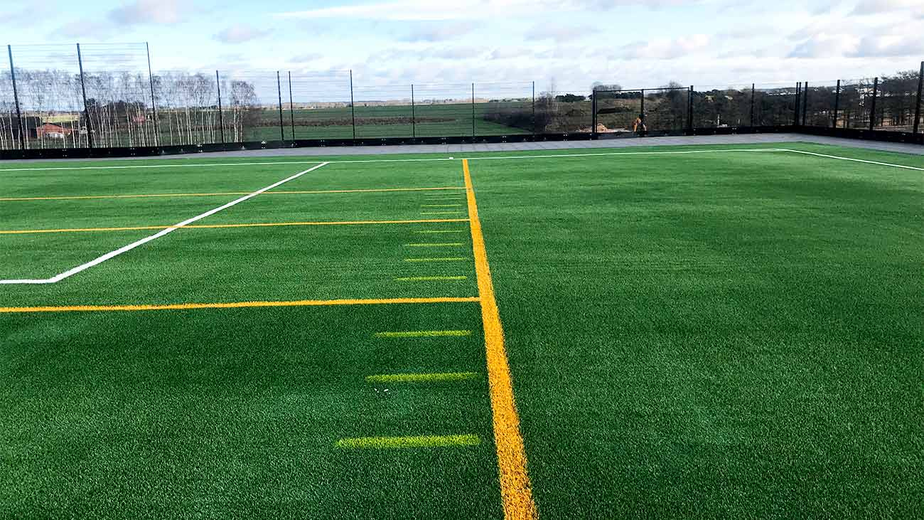 Soccer and American football on artificial turf